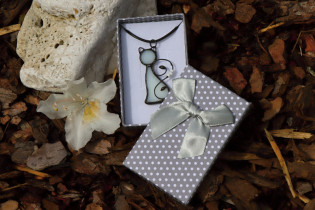 white cat in a gift box - Tiffany jewelry