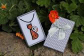 orange cat in a gift box - Tiffany jewelry